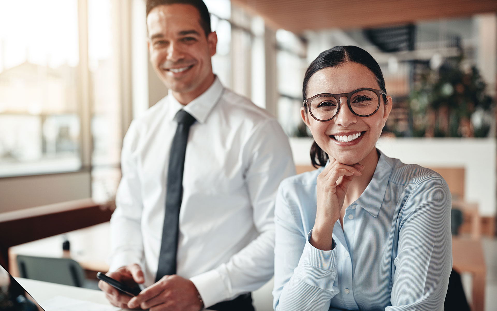 About Us - Woman and Man Business Employees in Modern Office Smiling